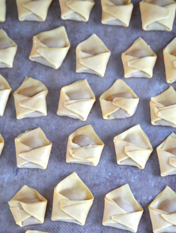This tested, easy-to-follow recipe for gluten free won ton wrappers and won ton soup will rock your gluten free world with how easy the wrappers are to make, and how useful they are!