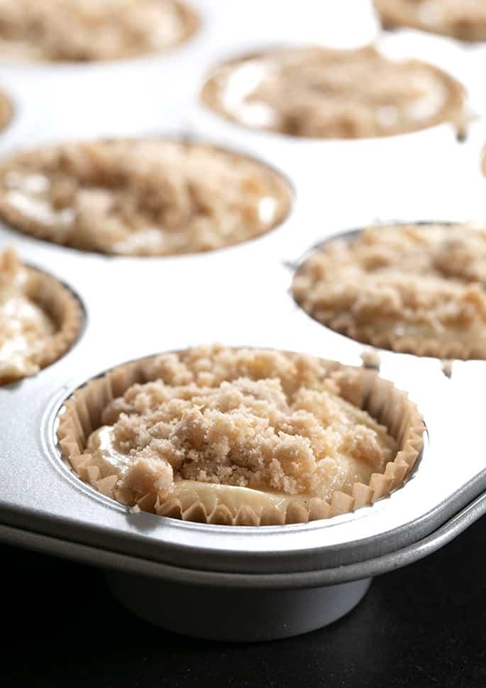 closeup image of raw gluten free coffee cake muffin batter in muffin tin