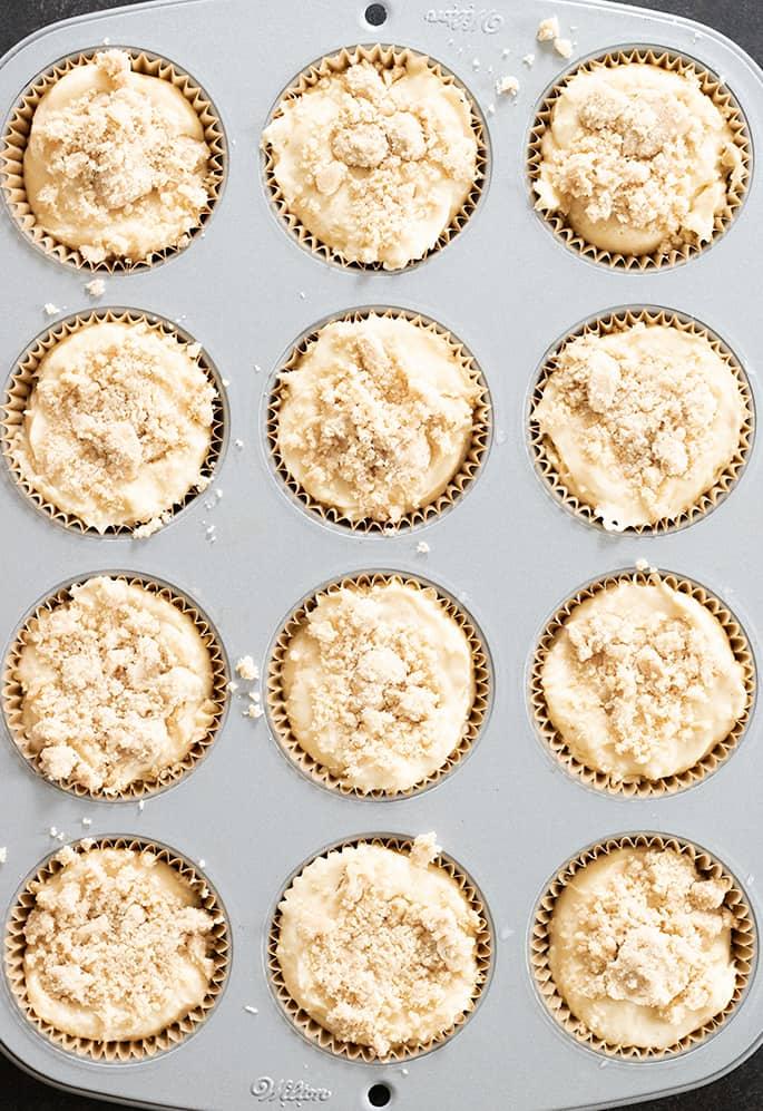overhead image of gluten free coffee cake muffins raw in muffin tin