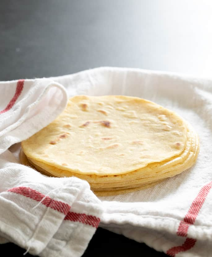 Tortillas on white and red towel