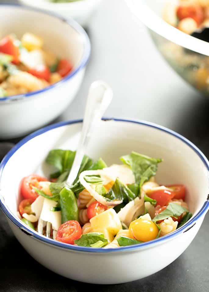 Warm gluten free pasta salad in bowls ready to eat