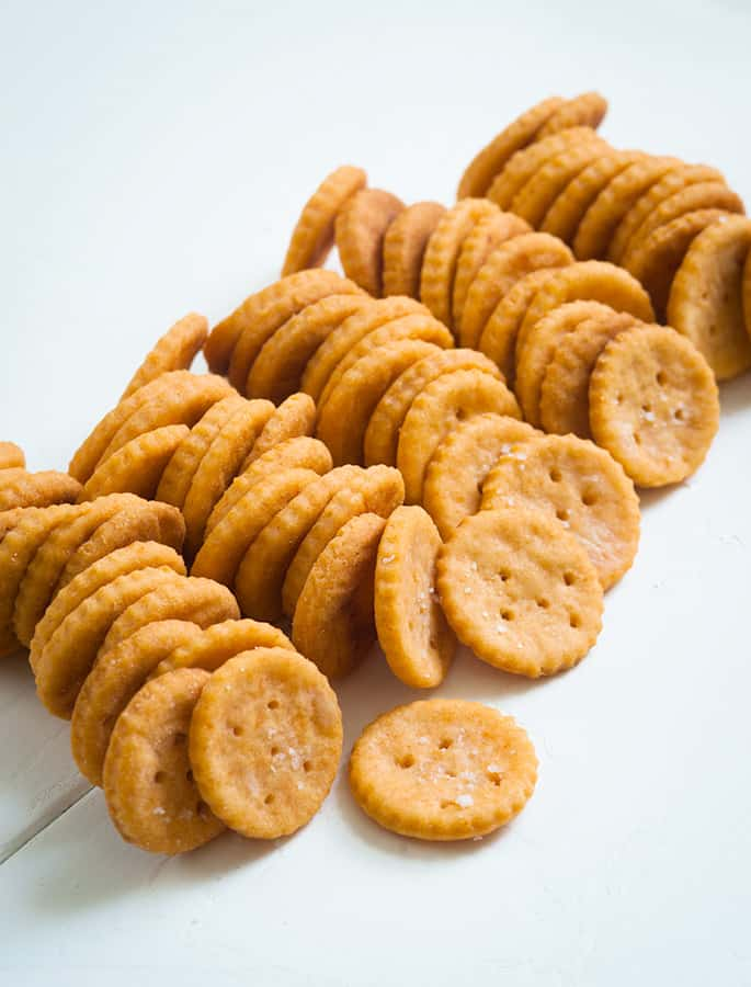 5 rows of Ritz-Style crackers on a white surface