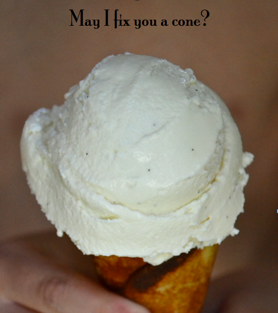 A close up of maple vanilla ice cream on a cone