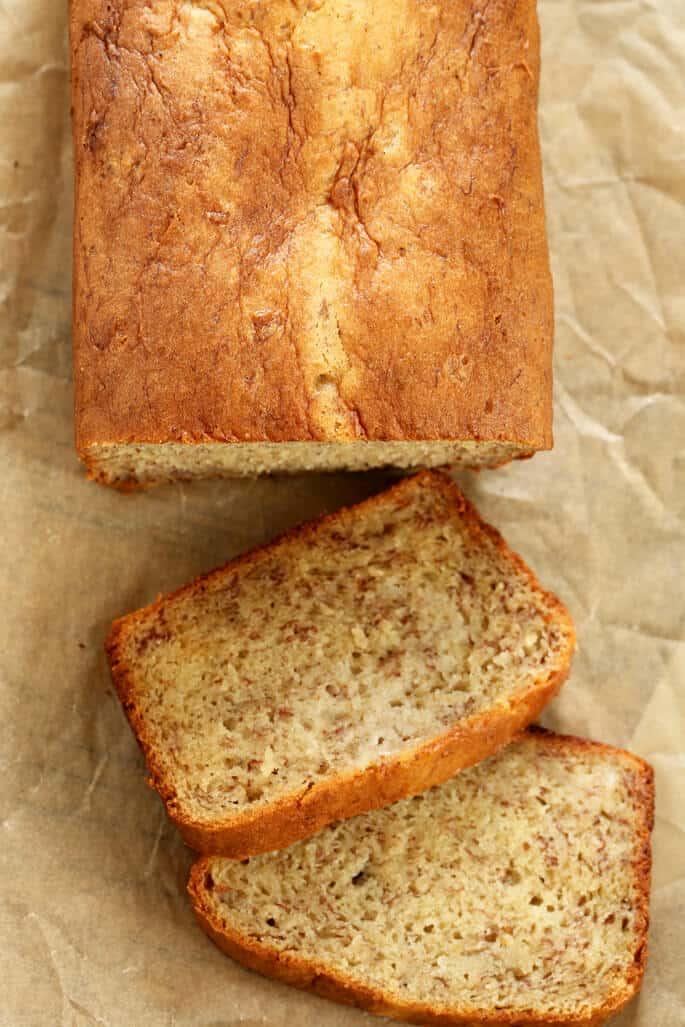 Overhead image of gluten free banana bread partially sliced