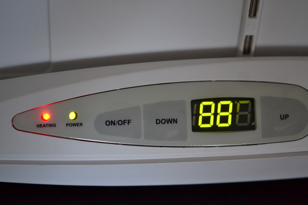 A clock on top of an oven