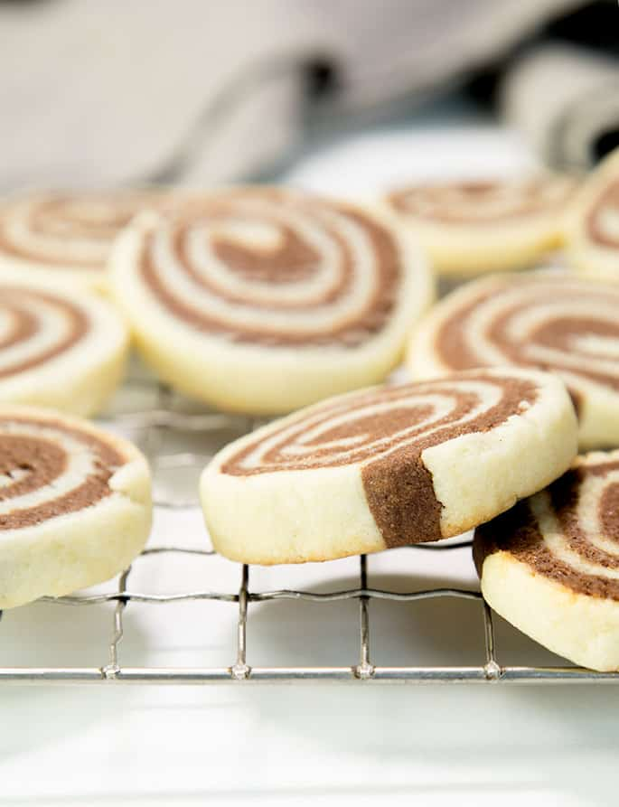 Direct angle of pinwheel cookies on metal tray