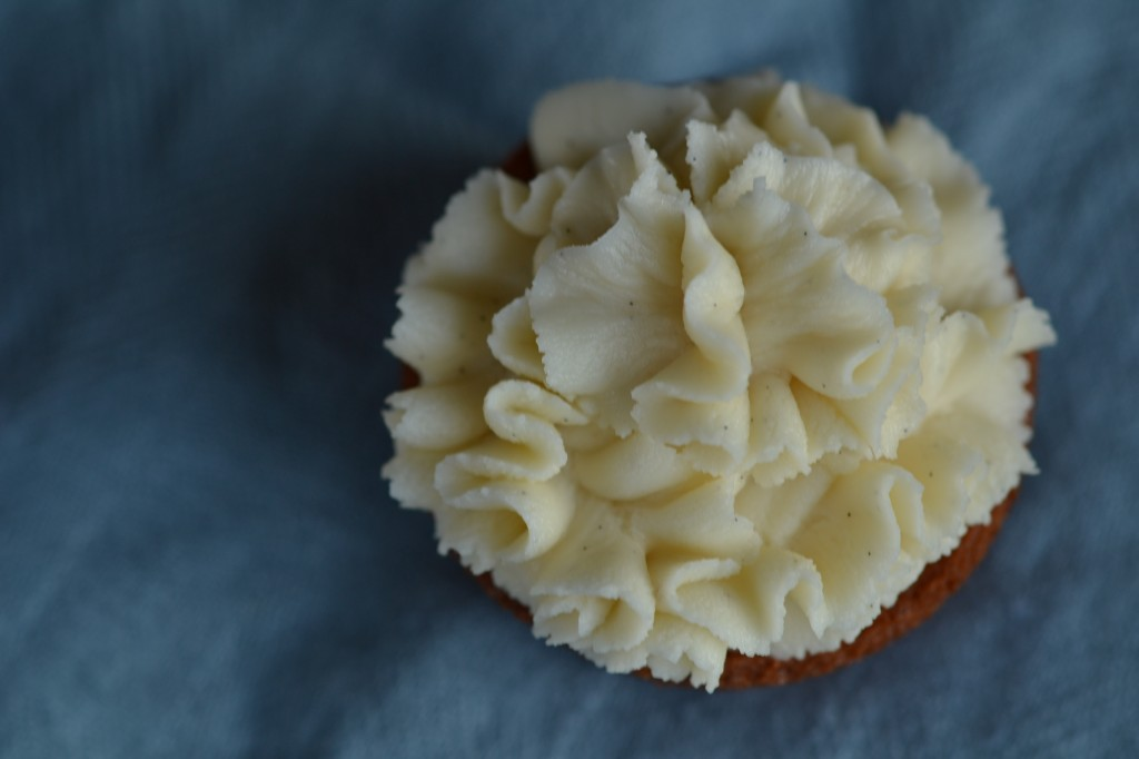 Overhead view of Cupcake with white chocolate frosting