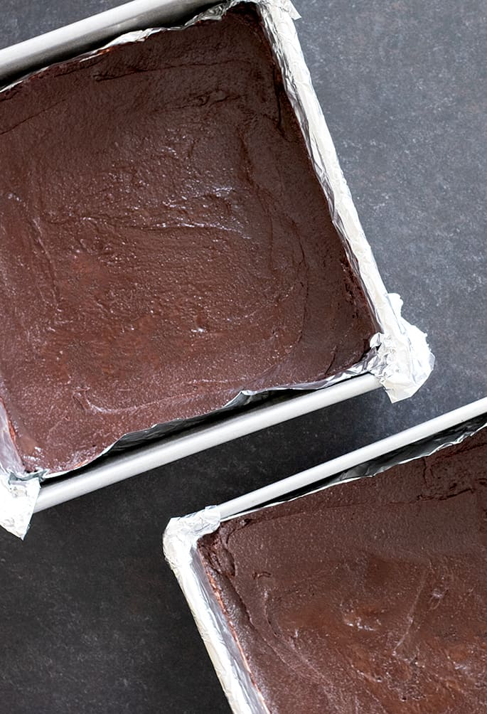 Grasshopper brownies raw in pans.