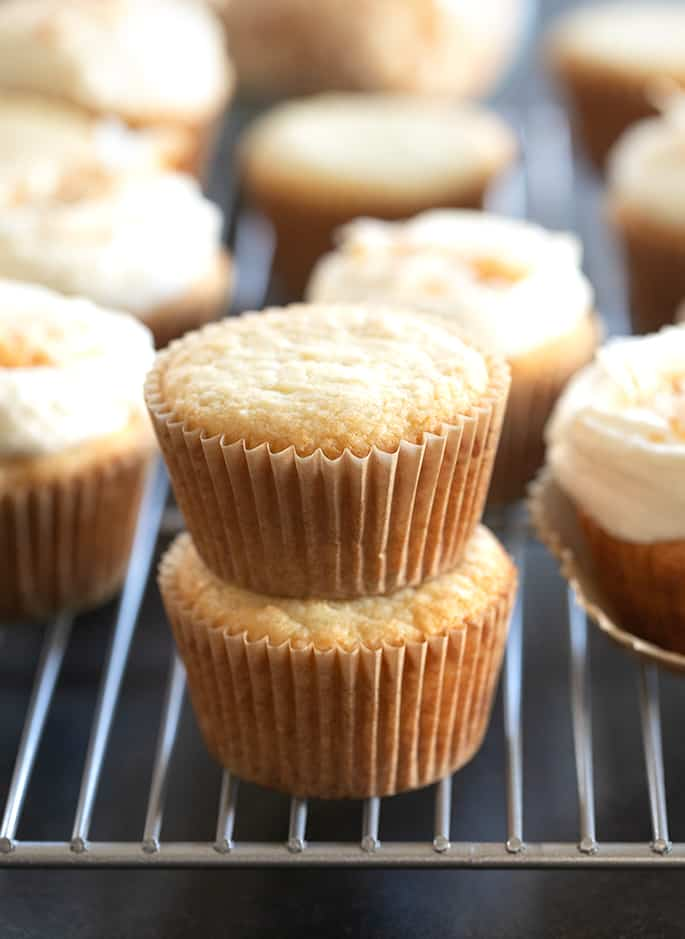 Coconut cupcakes in a stack on a wire rack