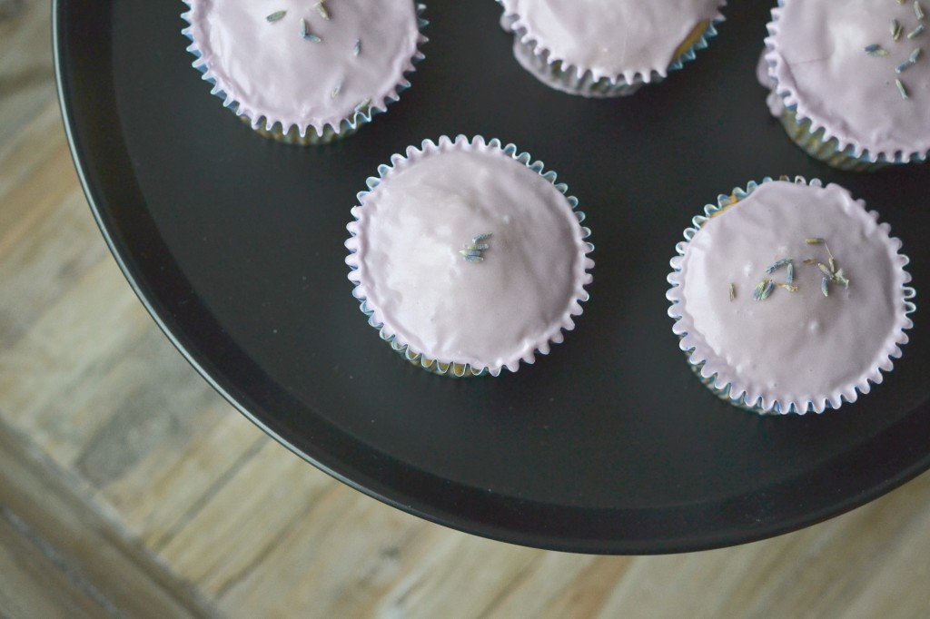 Lavender cupcakes on black surface