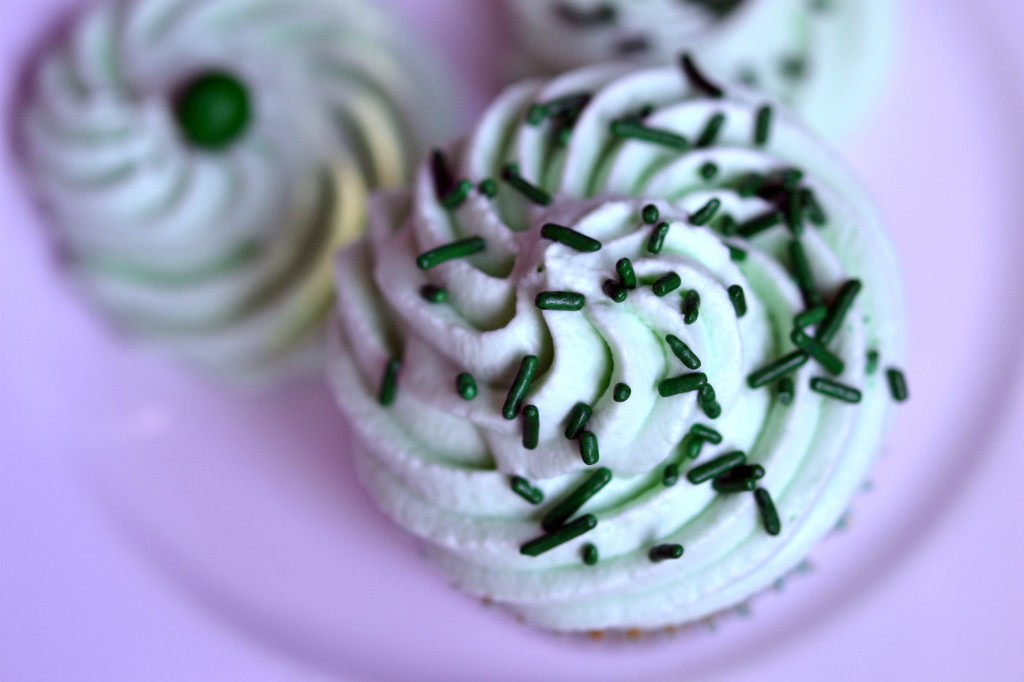 A close up of a decorated cupcake on a plate