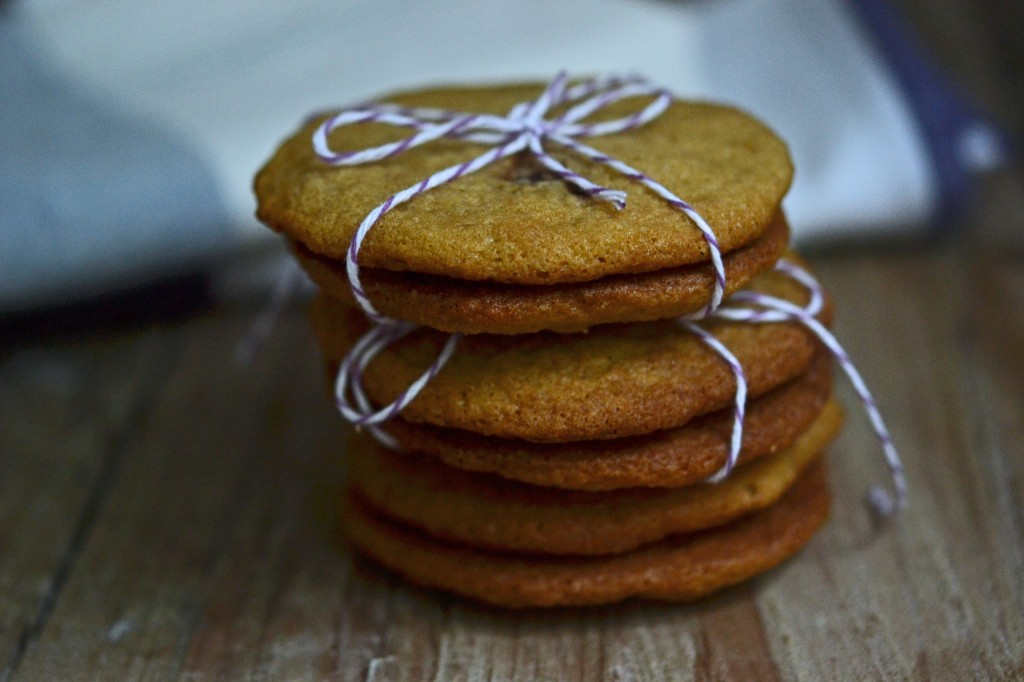 A stack of cookies on top of a wooden table