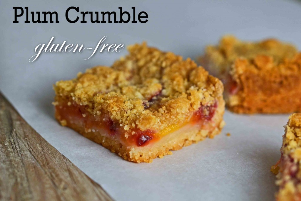 A close up of Plum crumble on white surface