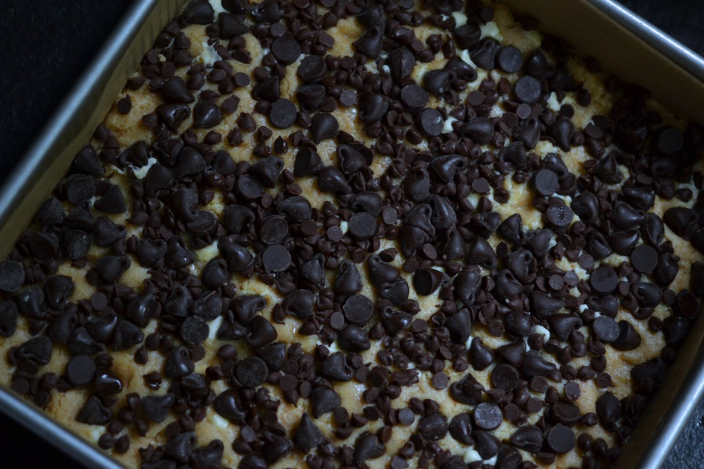 Chocolate chips and blondies in a pan
