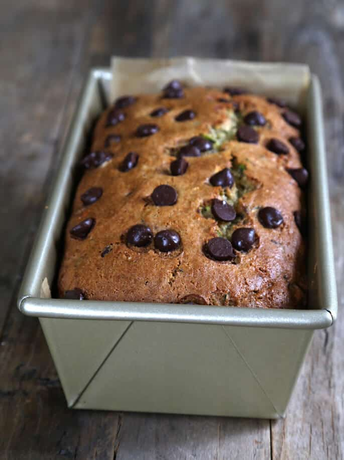 Gluten free chocolate chip zucchini bread baked in a loaf pan.