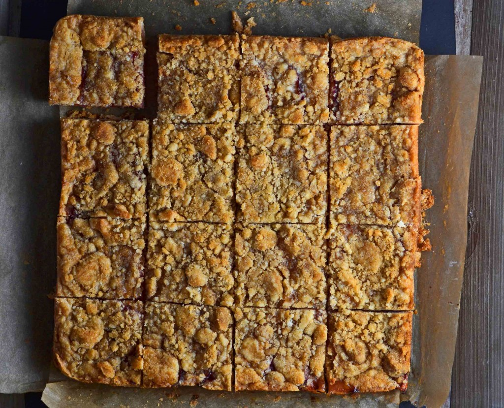 Sliced plum crumble on brown surface