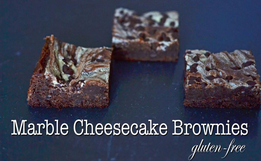 3 marble cheesecake brownies on black surface