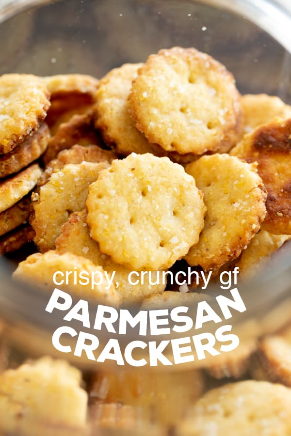 These super crisp gluten free parmesan crackers, made with Parmigiano Reggiano cheese and cornmeal, are perfect for snacking, packing in lunches, or serving as an appetizer. #glutenfree #gf #crackers