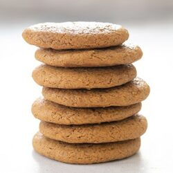 stack of 7 molasses cookies on white table