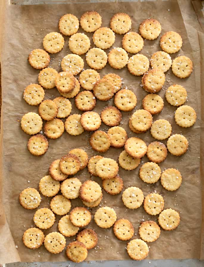 Overhead image of gluten free Parmesan crackers baked on a tray