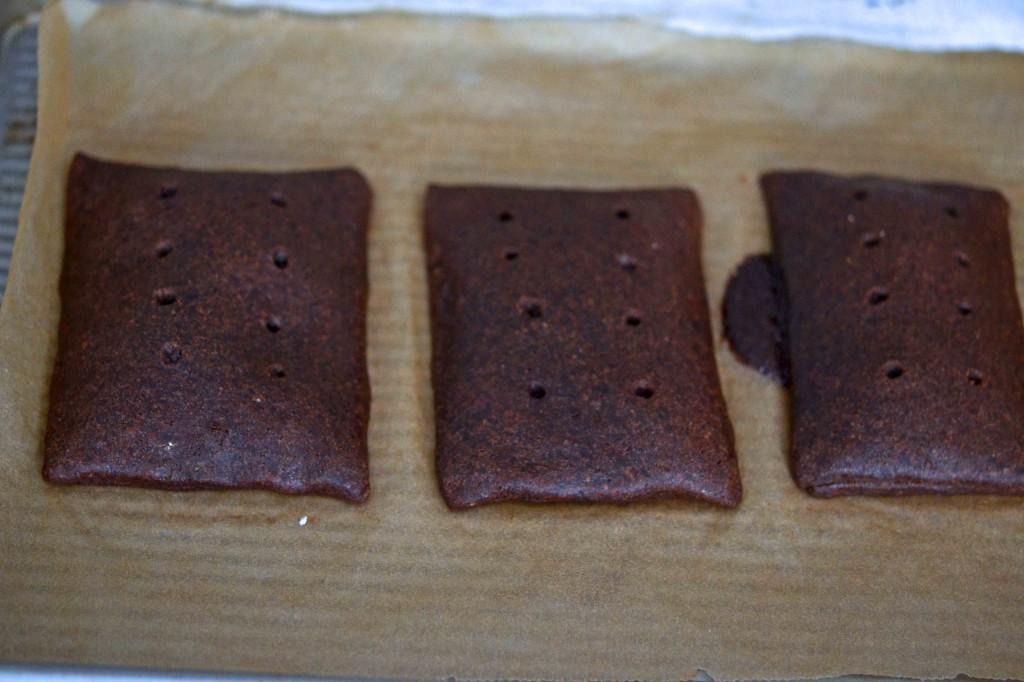 chocolate pop tarts on beige surface
