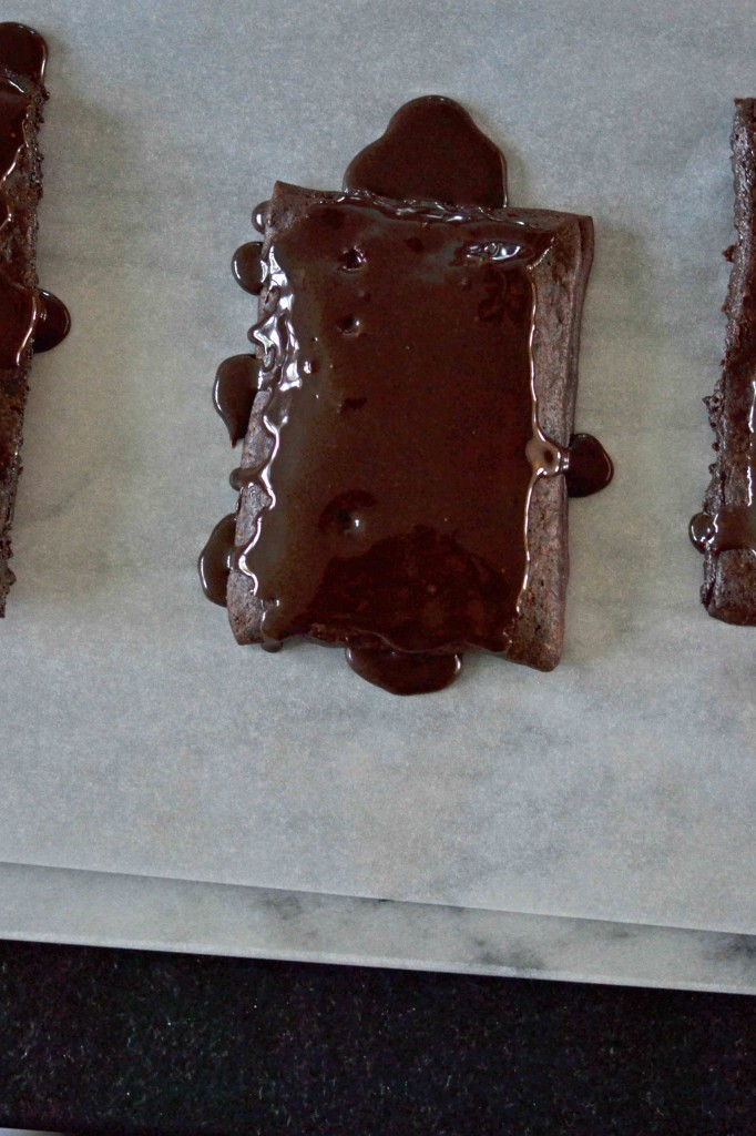 A chocolate pop tart being frosted