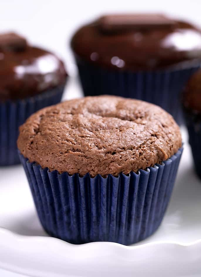 Baked milk chocolate cupcake without glaze and others with glaze