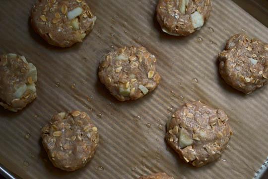 Shaped Apple breakfast cookie dough on beige surface