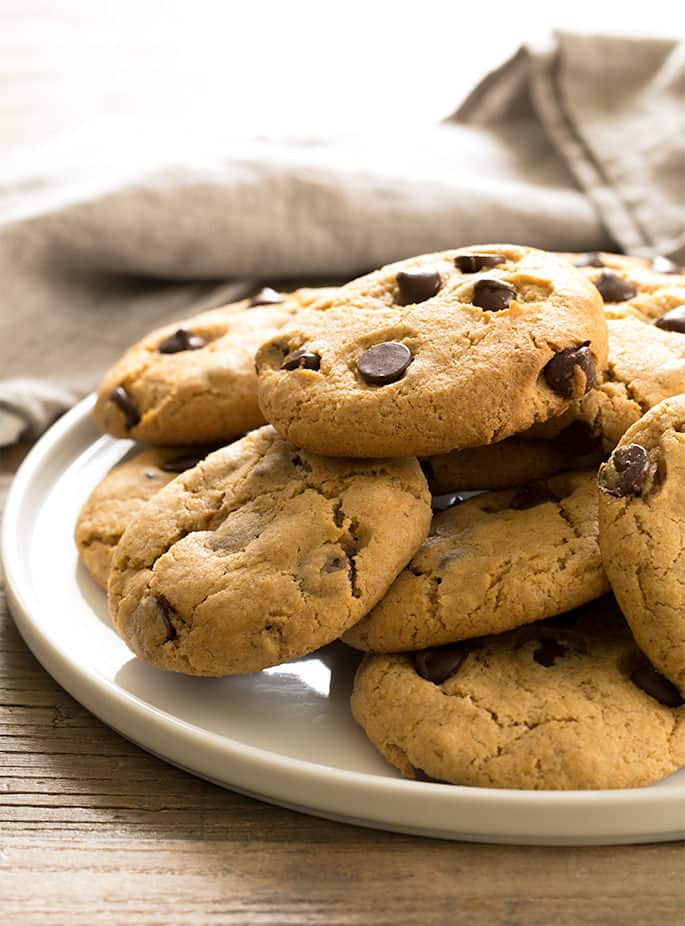 Traditional gluten free chocolate chip cookies get an upgrade with this recipe for bakery-style pumpkin chocolate chip cookies. Packed with fall flavors!
