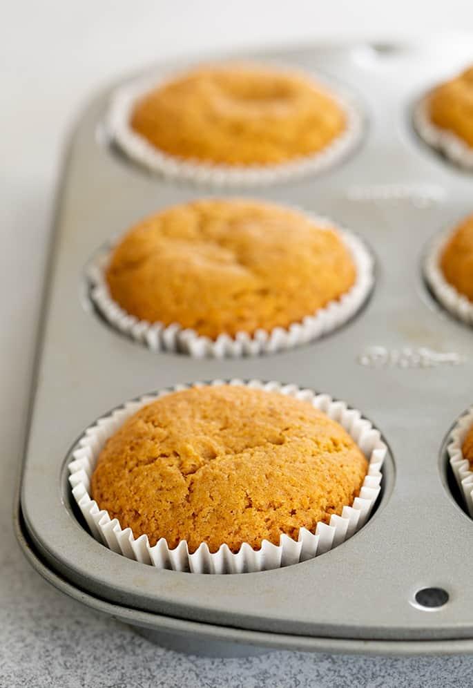 Pumpkin cupcakes baked in muffin tin