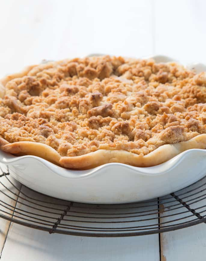 A close up of an apple pie in a white baking tray