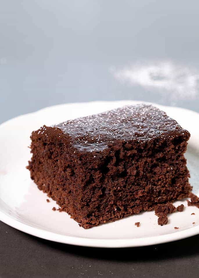 Rich chocolate and warm spices earn this moist and flavorful chocolate gluten free gingerbread cake a place of honor at your holiday table.