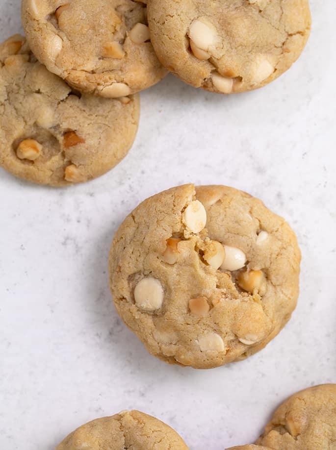 Overhead image of array of white chocolate macadamia nut cookies