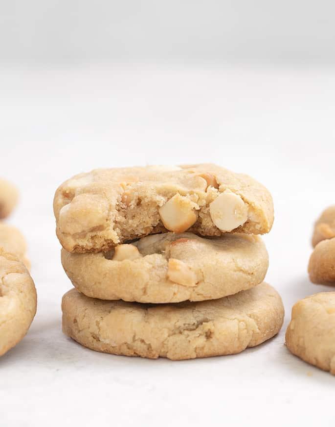 Stack of 3 white chocolate macadamia nut cookies