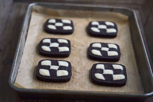 Checkerboard cookies on brown surface