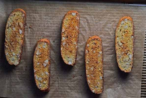 5 pieces of biscotti on beige surface