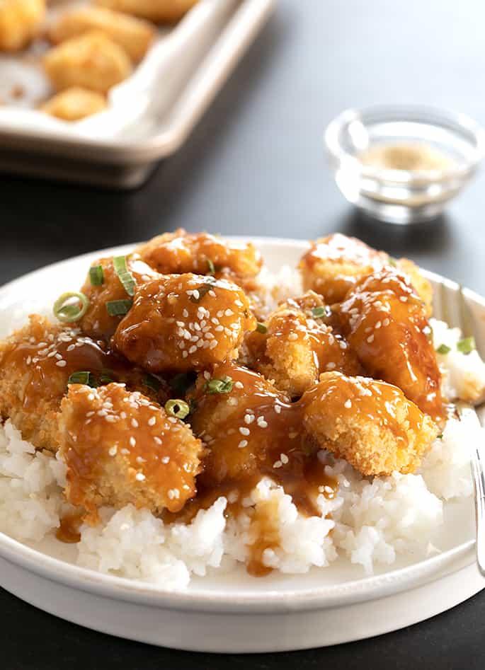 Gluten free sesame chicken being served.