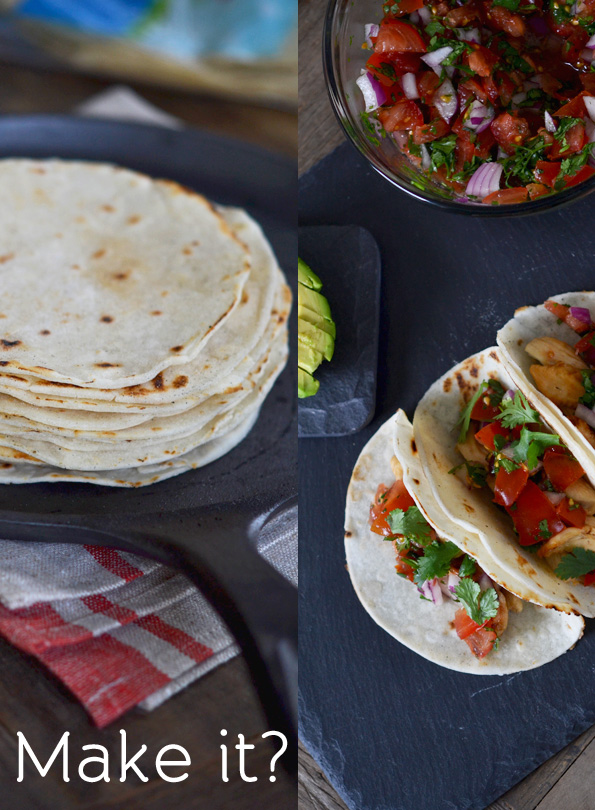 Stack of tortillas and tacos on black surface