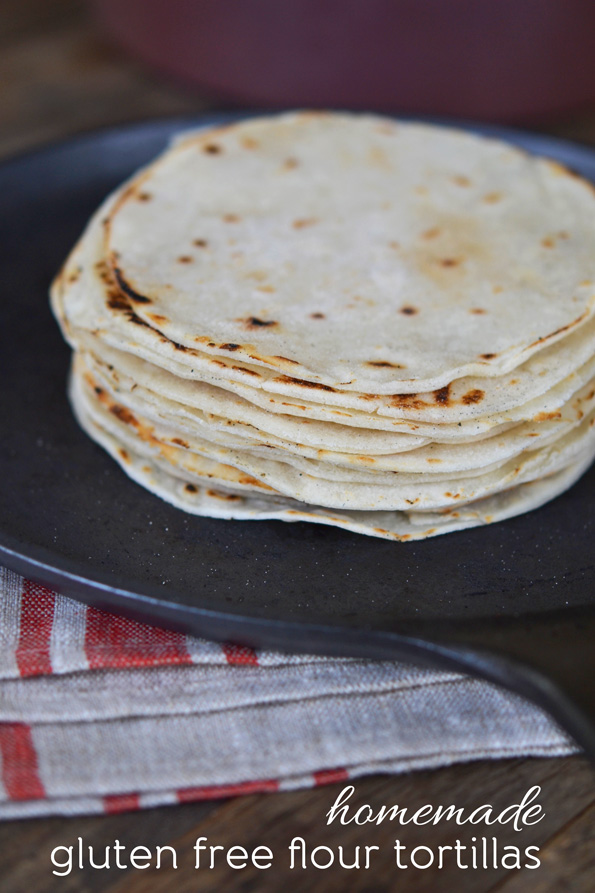 Stack of tortillas on black surface