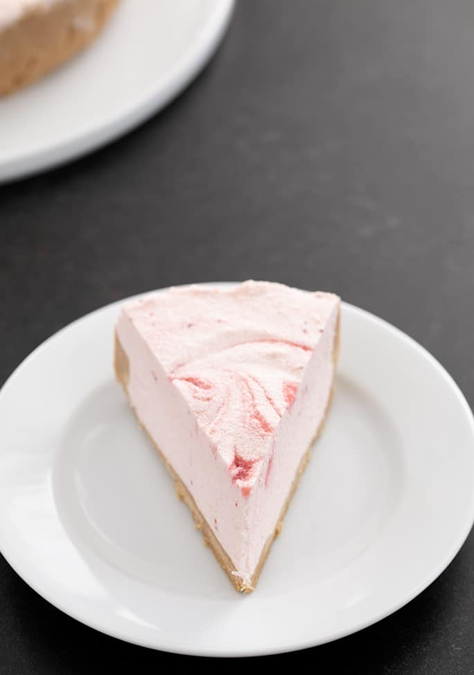 Strawberry yogurt pie slice on a plate