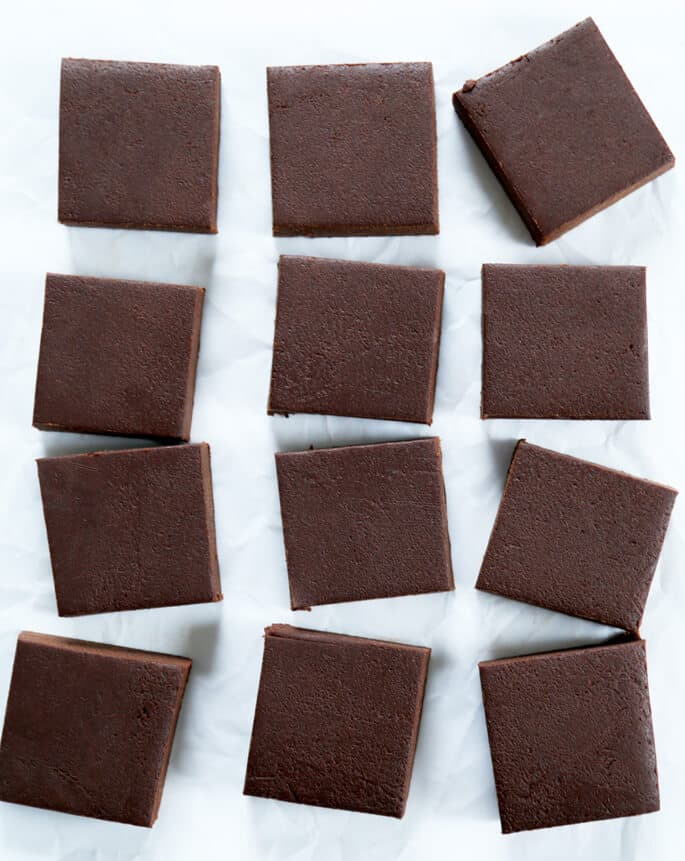 Overhead view of 4 rows of fudge on white surface