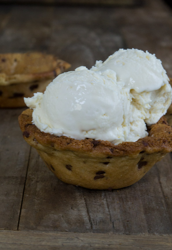 Close up of an edible ice cream bowl with vanilla ice cream inside of the bowl