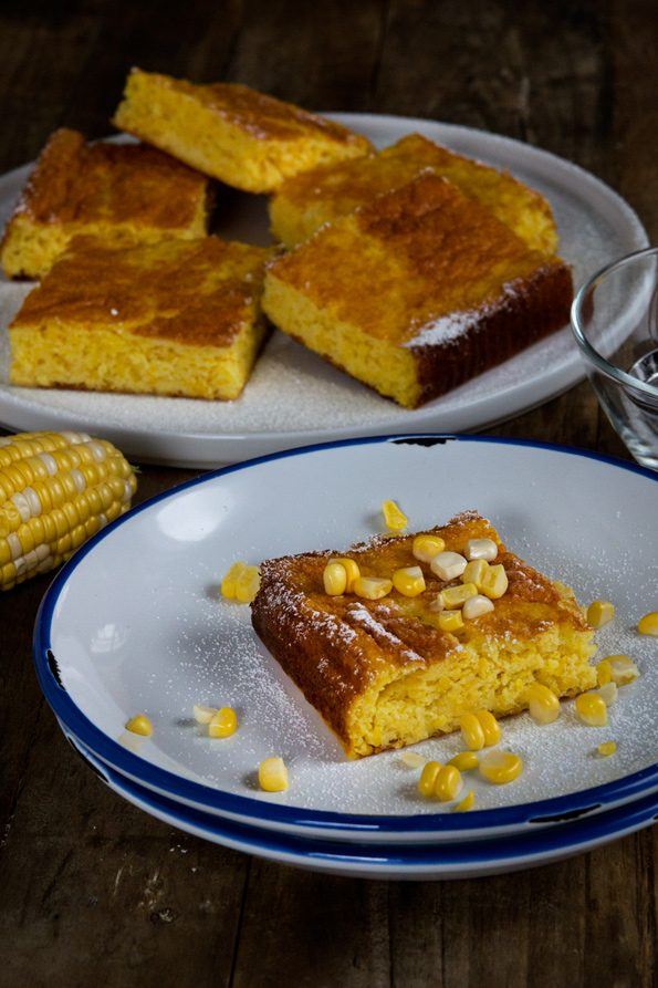 Piece of corn torte on white plate