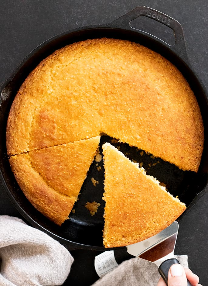 Old Fashioned gluten free cornbread all purpose flour variation, being sliced and served.