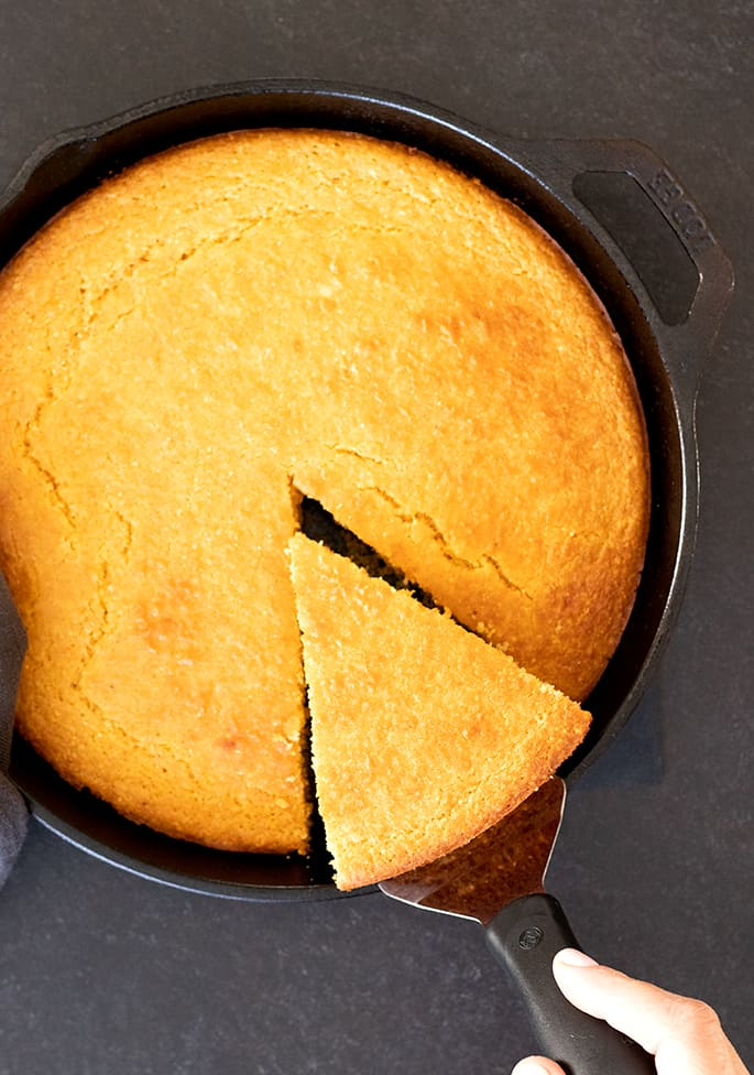 Old fashioned gluten free cornbread corn flour variation, being sliced and served.