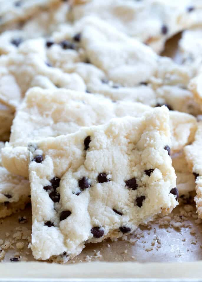A close up of cookie break up on beige surface