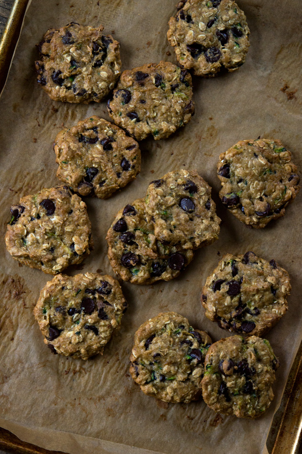 Overhead view of Zucchini Oatmeal Chocolate Chip Cookies on beige surface