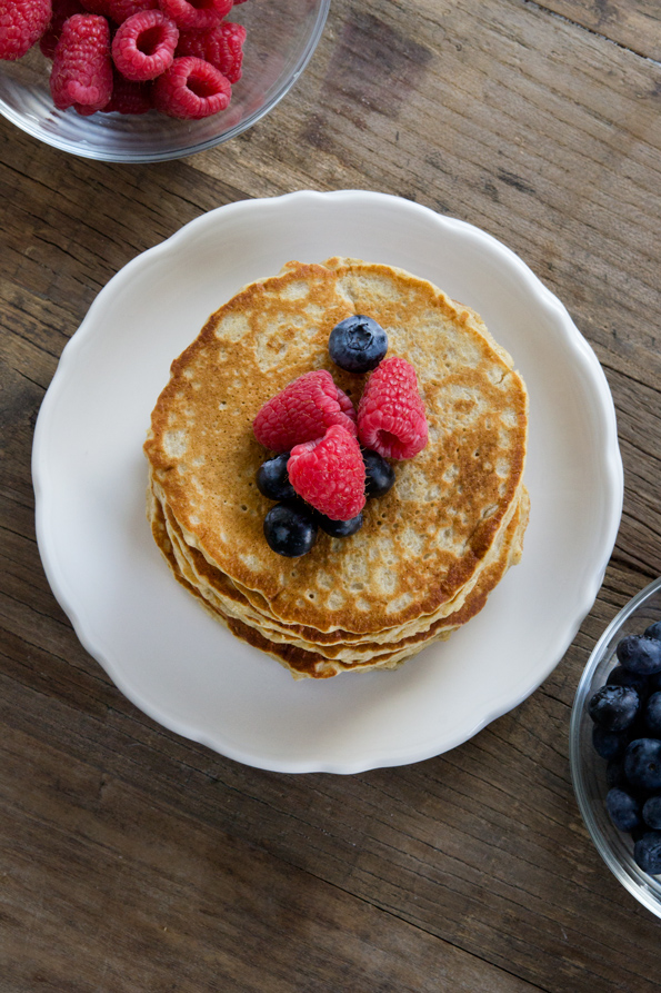 Overhead view of a stack of pancakes on a white plate