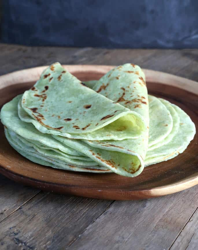 Made with pureed fresh zucchini in place of water, these soft, flexible gluten free zucchini tortillas are the perfect way to eat your greens.