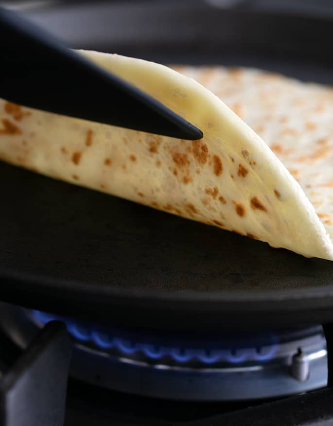 Flipping over a soft tapioca wrap with a spatula